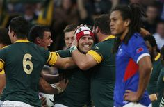 Schalk Brits is mobbed by his team-mates as South Africa created clear daylight between themselves and Samoa in the Pool B clash