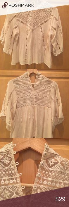Crop lace Blouse Cropped Lace Blouse hits right at the hip... I always get compliments on it.  Super cute with jeans or jean shorts or pencil skirts. Tops Blouses