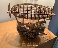 Puzzle en bois 3D Maquette DIY Puzzle mecanique Mecapuzzle DIY  Loisirs créatifs Idée cadeau Puzzle S Mo, Puzzle, Chandelier, Ceiling Lights, Check, Gifts, Home Decor, Wood Patterns, Creative Crafts