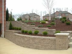 Pittsburgh retaining walls installation by PGHSW uses retaining wall block like Omni Stone and Versa-lok for it's retaining wall construction. Retaining Wall Construction, Patio Stairs, Stone Retaining Wall, Landscaping Retaining Walls, Privacy Walls, Evergreen Trees, Wall Installation, Pool Decks, Back Patio