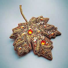 A beautiful beaded leaf, perfect for fall. Amazing bead embroidery!