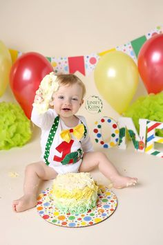 A photo from my son's 1st birthday cake smash photoshoot.  Background props and photo: Linsey Klein Photography   ONE prop, cake, and baby: Me   Outfit: RYLOwear on etsy.com