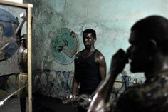 A handout photo released by the African Union-United Nations Information Support team shows a weight lifter training at a gym in the Hamar Weyne district of Mogadishu, Somalia. Tobin Jones—AFP/Getty Images