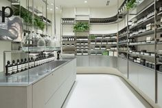 torafu architects sets tokyo's aesop store within a laboratory setting the australian skin care brand commissioned the architects at torafu to translate their innovative brand image into a new compact, clinic-influenced retail space in midtown toyko. Pop Design, Design Lab, Sketch Design, Tienda Aesop, Aesop Shop, Cosmetics Laboratory, Tokyo Midtown, Spaceship Interior, Retail Space