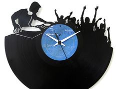 Bring a boost of whimsical, retro-inspired design to your decor with this laser cut wall clock from Vinyluse. Individually handcrafted, this creative yet functional work of art features an upcycled vinyl record modified with an intricately detailed motif. Each one is truly one of a kind, thanks in part to the characteristics and details of the discs themselves, resulting in a unique piece of wall decor perfect for showing off your personal style. Vinyl Record Clock, Vinyl Records, Music Graffiti, Marshmello Wallpapers, 480x800 Wallpaper, Dj Logo, Fancy Watches, Unique Clocks, Clock Art