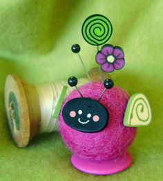 This adorable felt ball pin cushion is new from Just Another Button Company and on sale at your local needlework store as a kit. Oh, so cute!
