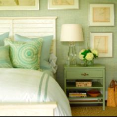 green and cream country style bedroom, wood headboard, painted side table