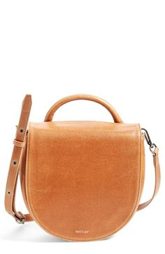 Free shipping and returns on Matt & Nat 'Parabole' Vegan Leather Crossbody Bag at Nordstrom.com. An of-the-moment saddle-bag silhouette makes this vegan-leather bag so chic, while a rolled top handle and adjustable strap offer styling convenience. A deep, roomy interior provides enough room for all your everyday essentials.
