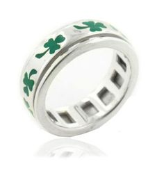 Irish shamrocks, an unofficial symbol of Ireland, are enameled in green around this band. Spinner rings are modeled after the Tibetan Prayer Wheel and have a center band that is free to move or spin around the ring. The shamrock was traditionally used for its medical properties and is now often used as a symbol for Ireland. It is also a common way to represent St. Patrick's Day, a holiday celebrated on March 17...