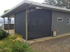 Before, this area would have been exposed to the elements, especially the wind. With a Roller Blind, enclosing an outdoor area creates a wind buffer, privacy and adds style. Roller Blinds, Shed, Exterior, Outdoor Structures, Garden, Outdoor Decor, Home Decor, Style, Swag