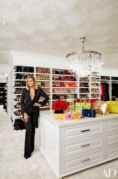 Khloe Kardashian isn't one to leave things in a mess. Her hyper-organized closet features built-in shelves and a gorgeous RH chandelier. | archdigest.com