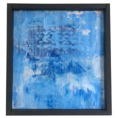 This painting is a an abstract original, painted in acrylic on wooden board. The colors are blue and white, which reminds us of a seascape of a cold ocean, dark mountains and sky. The frame is an icy silver with blue speckles to accentuate the blue hues in the painting.