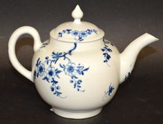 A WORCESTER TEAPOT of small size painted with the : Lot 1096  A WORCESTER TEAPOT of small size painted with the Prunus Root pattern workman's mark.
