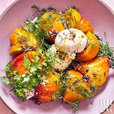 Heirloom Tomato and Burrata Salad- Edible flowers add a subtle herbal touch to this modern spin on an Italian Caprese salad.