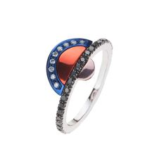 Nikos Koulis ring, from the new Acrobat collection, in black rhodium, with white and black diamonds and white gold hand-painted in blue, ora...