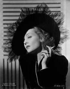 Carole Lombard smokes. 1938