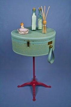 Vintage suitcase added to a stand...adorable way to show off your pretties!!