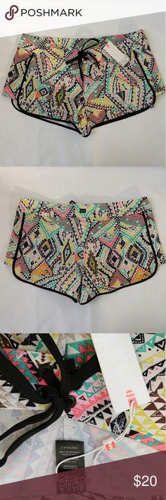 Billabong patterned swim shorts Size 9 patterned swim shorts, new with tags never worn Billabong Swim