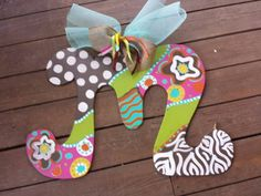 . Personalized Initial Wood door hanger These letters are hand painted with acrylic paint & accented with glitter puffy paint . they are made to your order, so feel free to customized any way you want. They are sealed to withstand the weather. All letters include a Mesh or Burlap