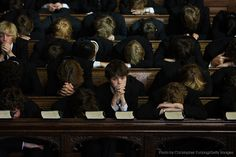 "reportagebygettyimages: "" Pupils of Eton College bow their heads in prayer during the daily service in College Chapel at the English private school, Eton College, June Eton College was founded. Boarding School Aesthetic, Slytherin Aesthetic, Cult, Old Money, The Secret History, Our Lady, Looks Cool, Light In The Dark, Hogwarts"