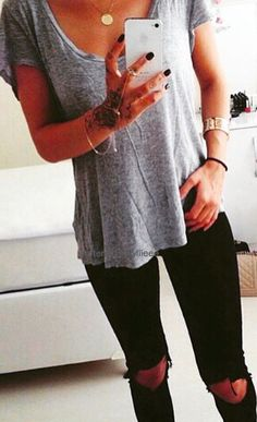 Gray top with black distressed jeans