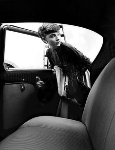 Audrey Hepburn getting into Studio car, 1953. by Bob Willoughby, via Flickr