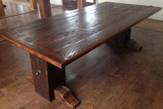 """Dining room table. Tabletop was made from 2x8s reclaimed from local late 1800s barns in North Texas. Base was made from hand hewn oak beams reclaimed from an 1850s barn in Ohio. Table is 8' x 40"""" wide. $2500.00"""