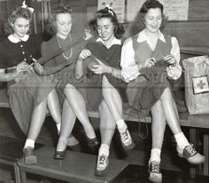 Four students volunteer knitting for the Red Cross in the Joint Universities Library building. [Vanderbilt University Photographic Archives]