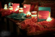 The soft candles and pastel saree hues create a romantic and mystical aura to this event - simply wonderful!