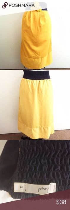 Super cute gold and navy blue skirt! Rich golden hue! Navy blue band at waist with elasticity! Floral trims in tact. Great condition, no stretch. Fits a medium. Measures 30 waist, 40 hips. 28.5 inches in length. Brand sold at Bloomingdales and Nordstrom. Hazel Skirts