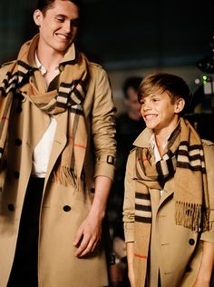 Heritage trench coats and scarves - Romeo Beckham wears a signature Burberry look for the festive film