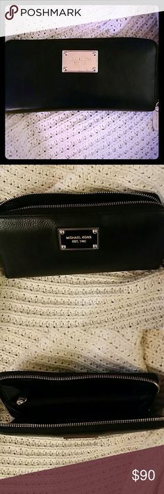 Michael Kors Jet Set Black Large  Leather Wallet Soft Black Leather MK jet set wallet with gold details. Small scratches on front gold plate...but other than that in great shape. Great size and fits perfect in the MK Hamilton Bag that I'm selling too! Michael Kors Bags Wallets