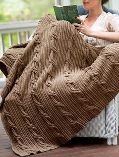 "Free Knitting Pattern for Schuyler Afghan - This throw from Berroco features asymmetric cables on a twisted rib background. Approximately 42"" wide x 60"" long."