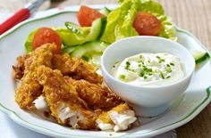 The kids are going to love making and eating these delicious cornflake chicken dippers. Each goujon is coated with a crunchy cornflake coating, which works wonders with the tender chicken. Delicious dunked in homemade cheese and chive dip.
