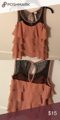 Dressy lace and ruffle tank Worn once or twice the ruffles give this top a flowy feeling while the lace trim with keyhole back give it a slight fancier feeling! LC Lauren Conrad Tops Tank Tops