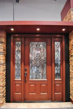 Clopay Arbor Grove Collection stained fiberglass entry door with Tuscany decorative glass and sidelights. www.clopay.com