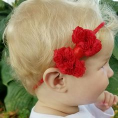 How sweet is this red bow headband? It's on a super soft nylon headband, and perfect for Christmas!