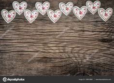 Valentines day ornament. Red hearts on wooden background. Greeting card blank