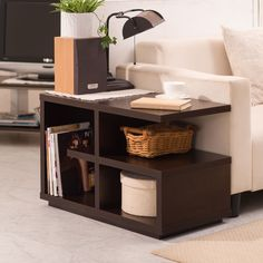 Treat your living space to a little modern eccentricity with this geometric and edgy end table. The walnut finish creates an inviting appearance while the many shelves upheld by the center panel provide plenty of elbow room and book shelf space.