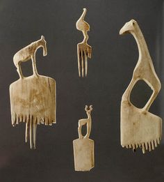 Egyptian hair combs with ostrich, giraffe, antelope, wildebeest, ca. 3700-3300 BCE; bone or elephant ivory