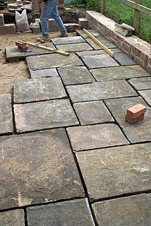 Unscripted shares a story of how a handy homeowner designed and built a large flagstone patio with irregularly shaped stones.