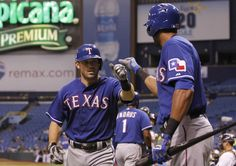 CrowdCam Hot Shot: Texas Rangers second baseman Ian Kinsler is congratulated by right fielder Alex Rios after scoring a home run on the first pitch in the first inning against the Tampa Bay Rays at Tropicana Field. Photo by Kim Klement