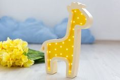 Giraffe Wooden Night Light  Bring the wonder of the universe to a childs bedroom with the Giraffe Wooden Night Light. Thanks to its low consumption and easy placement this decorative night light emits an ambient light to provide the right atmosphere for a child to feel soothed at night time.  #kidslamps #childishtales #lightupyourlife #nightlights #nurserylighting #kidsdecor #kidsroom #lamps #lightsforkids #nurserylamps  #nurserydecor #kidsdecor #lamps #kidsbedroom #homedecor #interiordesign…