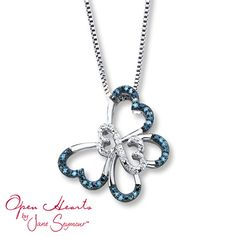 A charming butterfly features the iconic Open Hearts by Jane Seymour® design at its center and is adorned in round blue and white diamonds. The pendant sways from an 18-inch box chain that secures with a lobster clasp. The sterling silver necklace has a total diamond weight of 1/10 carat. Blue diamonds are treated to permanently create their intense blue color. Diamond Total Carat Weight may range from .085 - .11 carats.