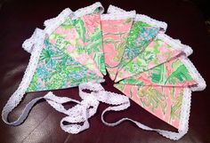 Cute banner for pink and green Lilly Pulitzer birthday party and later as a decoration in her room.  Purchase at www.etsy.com/shop/seasidepillows.