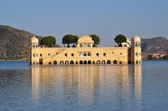 """Jal Mahal Jaipur, India - Jal Mahal (meaning """"Water Palace"""") is a palace located in the middle of the Man Sagar Lake in Jaipur city, the capital of the state of Rajasthan, India. The palace and the lake around it were renovated and enlarged in the 18th century by Maharaja Jai Singh II of Amber.The urban lake gets filled up during the rainy season."""