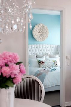 stunning Tiffany Blue wall color, pink flowers and chandelier. <3
