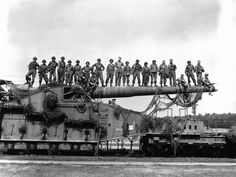 Was he up there?? -- American GIs pose atop monster German railway gun shortly after the Normandy landings, June-July 1944.