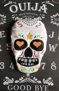 An embroidered vinyl purse, inspired by sugar skulls