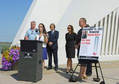 Gathered at the Postcards memorial in St. George for the announcement of Borough President James Molinaro's annual Sept. 11 Memorial Blood Drive are, from left: Dennis McKeon, Where to Turn; Miranda McAuliffe, New York Blood Center; Peter Tesoriero of St. Sylvester R.C. Church; Michele LaRiviere, the director of the New York Blood Center; and Joseph McAllister of Moe's Southwest restaurant. #honor911